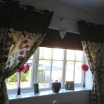 A Lovely Maroon Roman Blind to Complement The Curtains